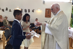 Receiving their certificates and rosary beads