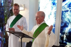 Deacons Christian and David lead the Sunday Service of the Word