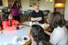 Fr. Peter spends  time getting to know the children